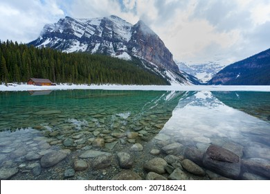 Lake Louise half frozen in summertime