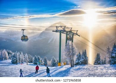 Lake Louise Ski Resort. Lake Louise. Banff. Alberta. Canada. Dec. 26 2018.  Skiers were admiring the sunset while skiing down the hill.