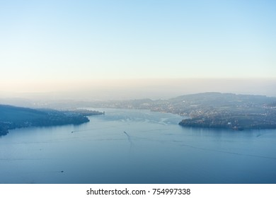lake lucerne with mountain and fog close to sunset
