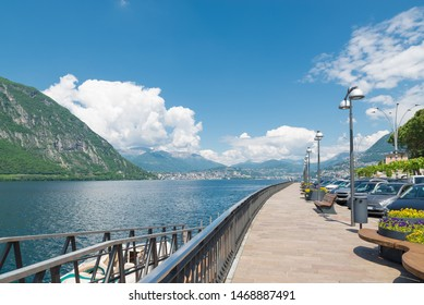 Lake Lugano and Campione d'Italia, Italy. City known for the casino. Lakefront promenade and the city of Lugano in the background, summer landscape
