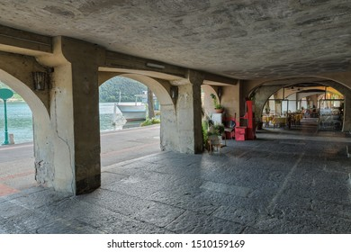 Lake Lugano, Morcote. Ancient arcades built between 1300 - 1500 among the most beautiful in the Canton Ticino, Switzerland. They house typical restaurants and characteristic shops overlooking the lake
