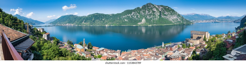 Lake Lugano. Panoramic view of Campione d'Italia, famous for its casino. In the background on the right the city of Lugano, in the middle Monte San Salvatore, on the left Melide and Monte San Giorgio