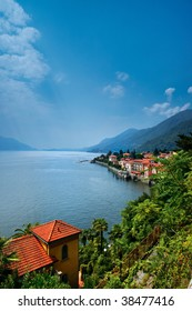 Lake Maggiore. Aerial view of Lake Maggiore with homes on shoreline, Italy.