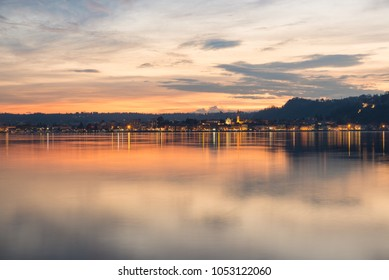 Lake Maggiore, colorful sky at sunset, northern Italy. City of Arona, province of Novara, on the Piedmont side of Lake Maggiore, view from Angera