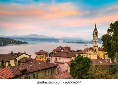 Lake Maggiore, Laveno, Italy -  early morning. Picturesque sunrise over the lake Maggiore. Landscape toward the Piedmont shore between Stresa and Pallanza. In the background the snow-covered Alps