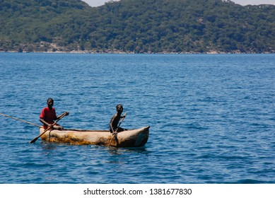 Lake Malawi, Malawi, 4/3/07  Two men in a canoe on Lake Malawi, Malawi