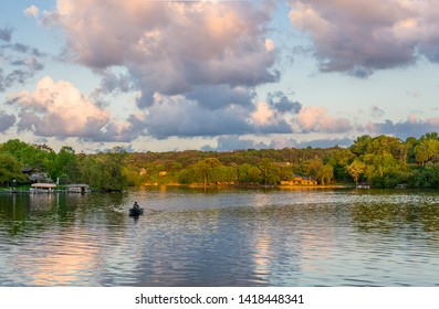 Lake Mallalieu in western Wisconsin at sunset with a single 5boater on reflecting water.