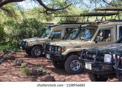 Lake Manyara NP, Arusha / Tanzania - 12 December 2017: Toyota Landcruiser cars during lunch time in Manyara National Park