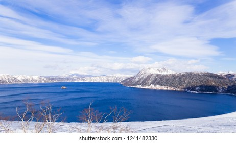 Lake Mashu(Mashuko) in winter with line of cloud and snow capped the mountain,Hokkaido,Japan