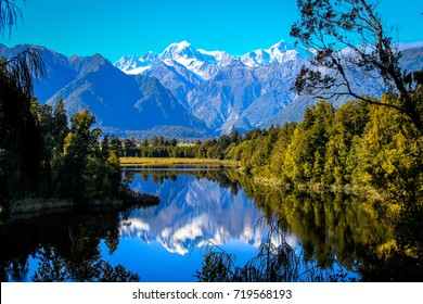 Lake Matheson with Aoraki Mt. Cook Mirror in Fox Glacier, South New Zealand.