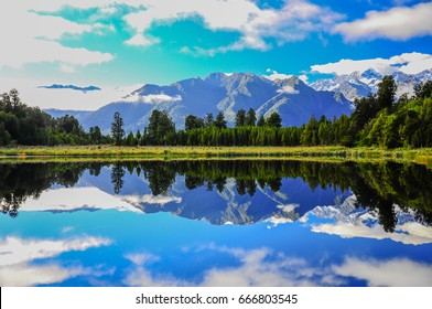 Lake Matheson, near the Fox Glacier in South Westland, New Zealand, is famous for its reflected views of Aoraki/Mount Cook and Mount Tasman
