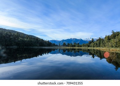 Lake Matheson, South Island, New Zealand Reflection of Mount Tasman and Mount Cook