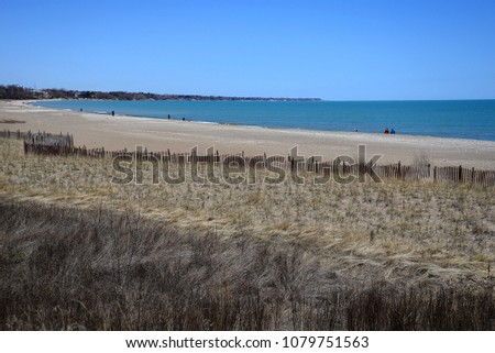 4f093ee8be7 Lake Michigan beach on a cool spring sunny day in Kenosha Wisconsin. Peer  north to