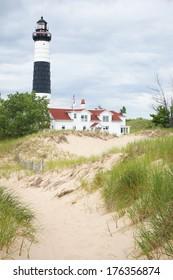 Lake Michigan Lighthouse Ludington Big Sable Lighthouse on the shore of Lake Michigan. Sand dunes in foreground.