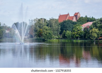 Lake in the middle of Ilawa town in Poland, view with Church of Transfiguration