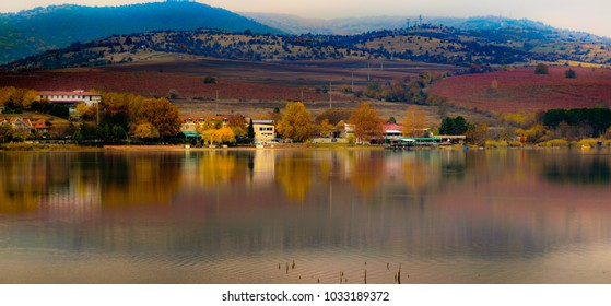 Lake Mladost shore resorts camouflaged by the autumn colors of the surrounding nature.
