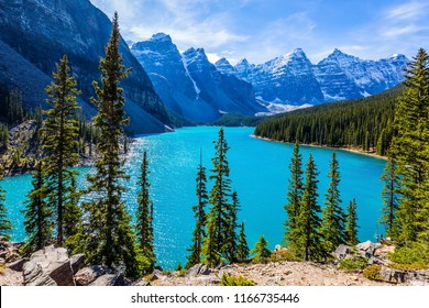Lake Moraine with water of emerald color in the Valley of the Ten Peaks. Park Banff, Canadian Rockies, Province of Alberta. The concept of ecological, photographic and active tourism