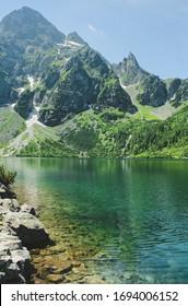 The lake Morskie Oko or Eye of the Sea. Western Carpathian mountains. The Tatra National Park in the Rybi Potok (the Fish Brook) Valley, Zakopane, Poland. - Shutterstock ID 1694006152