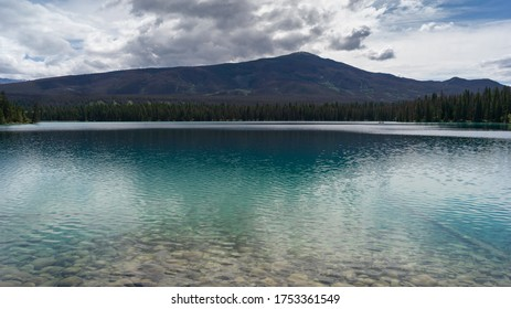 Lake with mountain range in the background, Annette Lake, Jasper National Park, Alberta, Canada