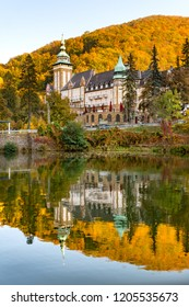 Lake in the mountains with autumn colours with a fairytale castle in Lillafured, Miskolc, Hungary