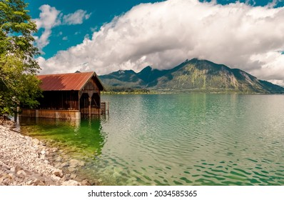 Lake in the mountains. Beautiful landscape scenery in upper Bavaria. Reflection Lake Walchensee with Boathouse at a lake. European Alps in Germany, Europe Bavarian Prealps