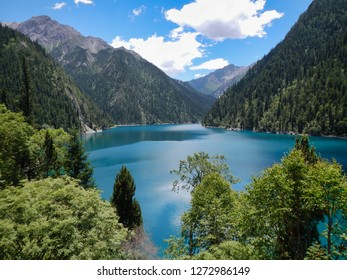 Lake and mountains covered with trees in the national park of Jiuzhaigou, Sichuan, China