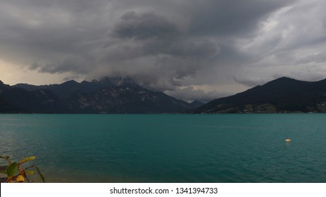 A lake in the mountains during stormy weather. Location: Europe, Austria, Attersee