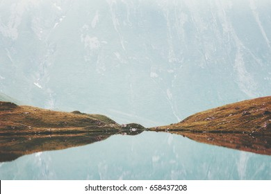 Lake and Mountains mirror reflection water minimal Landscape Summer Travel calm serene aerial view