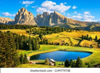 Lake and mountains at sunset, Alpe di Siusi or Seiser Alm, Dolomites Alps Sassolungo and Sassopiato, Trentino Alto Adige Sud Tyrol, Italy, Europe