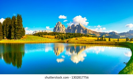 Lake and mountains at sunset, Alpe di Siusi or Seiser Alm, Dolomites Alps Sassolungo and Sassopiato, Trentino Alto Adige Sud Tyrol, Italy, Europe
