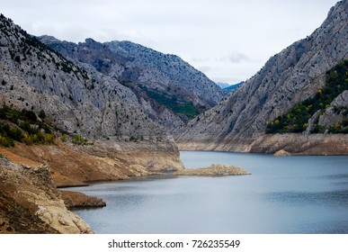 Lake in mountains. With white things. Drought