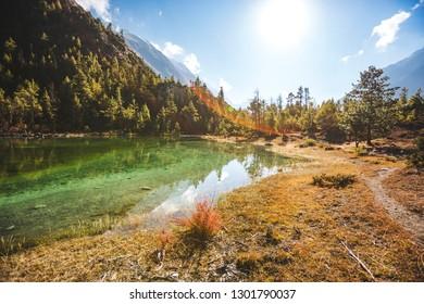 Lake Mricho Tal with water of emerald color near Pisang. Himalaya mountains in Nepal, Annapurna circuit trek