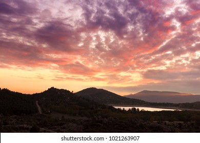 The lake of Navacerrada between mountains photographed in the amazing sunset at the end of autumn. Madrid, Spain.