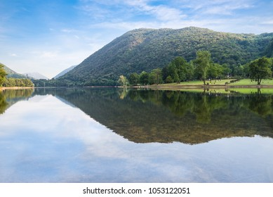 Lake in northern Italy. Lake Ghirla, a tourist itinerary in the province of Varese, between the villages of Ganna and Cunardo, Lombardy on a beautiful summer day