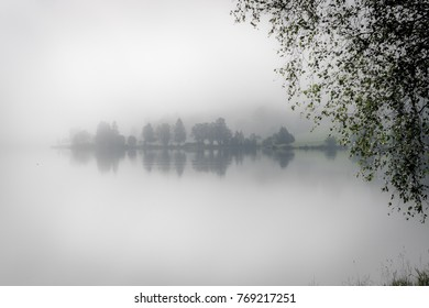 Lake in Norway with for and trees