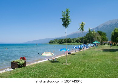 LAKE OHRID, REP. OF MACEDONIA - CIRCA JULY 2016: Holidaymakers relax by St Naum beach on the shores of Lake Ohrid