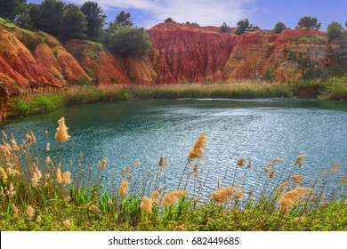 The lake in a old bauxite's quarry in Apulia, Otranto, Salento, Italy.The digging was filled with natural waters. A small lake ecosystem has thus been created, example of spontaneous renaturalization.