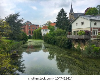 Lake and old factory in Kettwig, a district of the German city of Essen
