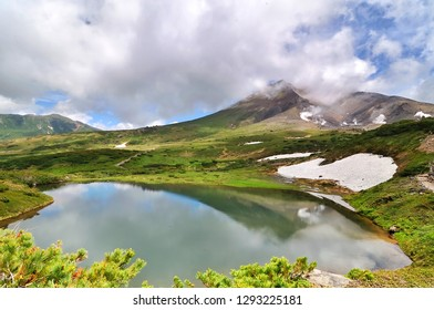 The lake on Asahi-dake Mountain (Mt. Asahidake), Higashikawa, Highest Mountain in Hokkaido in early summer.