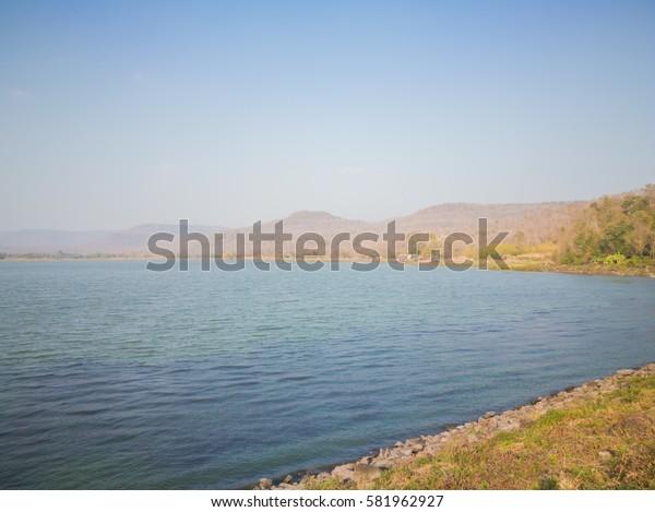 Lake on mountain overlay with gradient sky, Kalasin Thailand