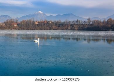 Lake on Sava river with Kamnik-Savinja Alps in Medno, Slovenija