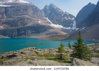 Lake Osea with trees, glaciers, and mountains