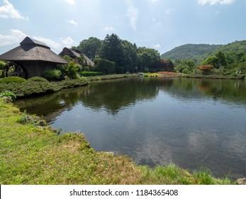 Lake at Oshino Hakkai village, Japan. Oshino Hakkai is a small village in the Fuji Five Lake region, located between Lake Kawaguchiko and Lake Yamanakako.