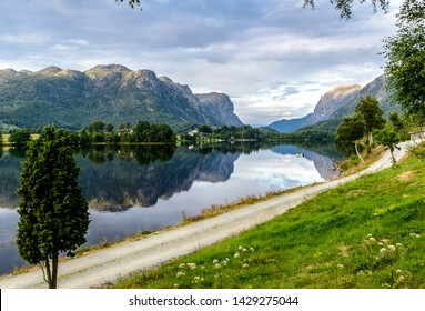 Lake Ostrehusvatnet Idyllic view with boat, mountains reflection (reflexion) nearby Tau, Stavanger. Norway