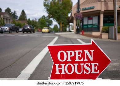 """Lake Oswego, Oregon, USA - Sep 14, 2019: An """"Open House"""" sign is seen by the roadside in Lake Oswego, a southern suburb within the Portland metro area."""