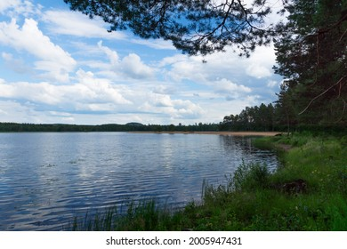 Lake Bysjön outside Nås, Dalarna. In the distance, the beach in Närsjö.