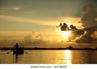Lake with a paddle boat in Myanmar around sunset time