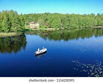 Lake panorama with fishing guys