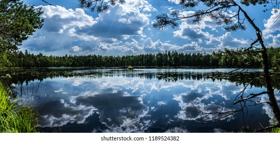 Lake Panorama in national park near Helsinki, Finnland during the summer, clouds reflection