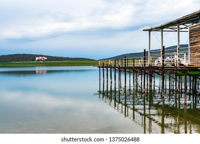 lake, pier and mountain view from the beach